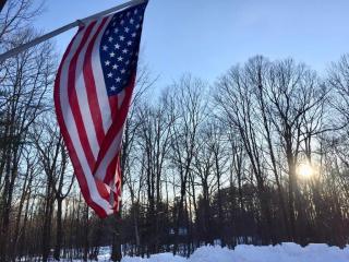 flag against a sunrise