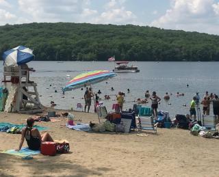 Photo of people enjoying the beach on July 4, 2018